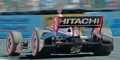 Blue, Automotive design, Transport, Bumper, Race track, Race car, Formula one car, Machine, Formula one tyres, Synthetic rubber,