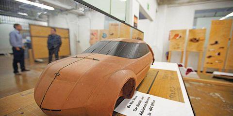 Motor vehicle, Automotive design, Wood, Floor, Vehicle door, Fender, Flooring, Concept car, Hardwood, Auto part,