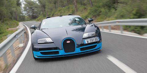 Motor vehicle, Automotive mirror, Mode of transport, Automotive design, Road, Vehicle, Grille, Performance car, Car, Hood,