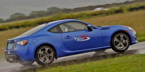 Tire, Wheel, Blue, Automotive design, Vehicle, Performance car, Car, Automotive lighting, Fender, Rim,