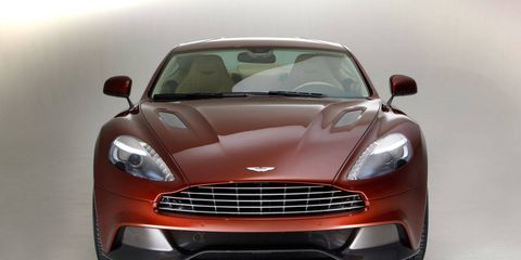 Automotive design, Product, Red, Car, Grille, Automotive lighting, Hood, Luxury vehicle, Headlamp, Windshield,