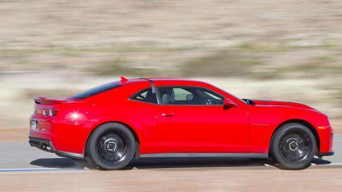 Tire, Wheel, Automotive design, Vehicle, Performance car, Automotive tire, Automotive exterior, Car, Red, Rim,