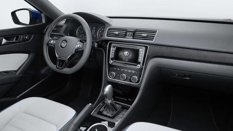 Motor vehicle, Steering part, Automotive design, Steering wheel, Automotive mirror, Vehicle audio, Center console, White, Radio, Personal luxury car,
