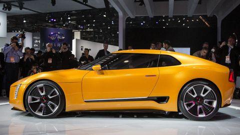 Clothing, Tire, Wheel, Automotive design, Vehicle, Event, Yellow, Land vehicle, Car, Performance car,