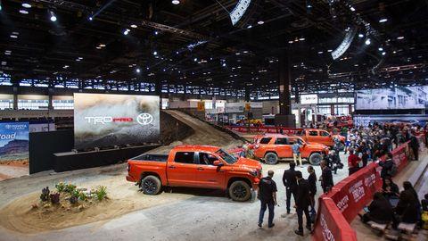 Vehicle, Land vehicle, Automotive parking light, Car, Automotive tire, Hardtop, Vehicle door, Hall, Exhibition, Auto show,
