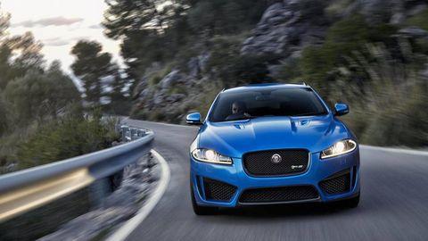 Automotive design, Blue, Road, Vehicle, Land vehicle, Grille, Car, Hood, Headlamp, Automotive mirror,