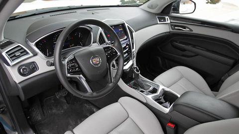 Motor vehicle, Steering part, Automotive design, Product, Steering wheel, White, Center console, Technology, Vehicle door, Automotive mirror,