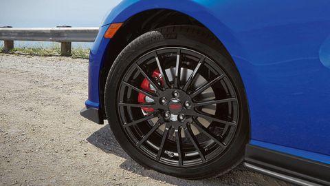Motor vehicle, Tire, Automotive tire, Blue, Automotive design, Alloy wheel, Vehicle, Automotive wheel system, Automotive exterior, Rim,