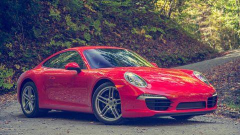 Tire, Wheel, Automotive design, Vehicle, Land vehicle, Car, Rim, Red, Alloy wheel, Performance car,