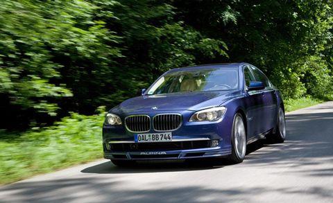Automotive design, Vehicle, Road, Grille, Hood, Automotive exterior, Car, Rim, Automotive lighting, Road surface,