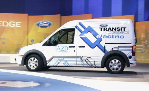 Motor vehicle, Wheel, Transport, Vehicle, Van, Rim, Automotive tire, Fender, Automotive parking light, Logo,