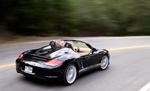 Tire, Wheel, Automotive design, Road, Vehicle, Automotive lighting, Road surface, Asphalt, Performance car, Car,