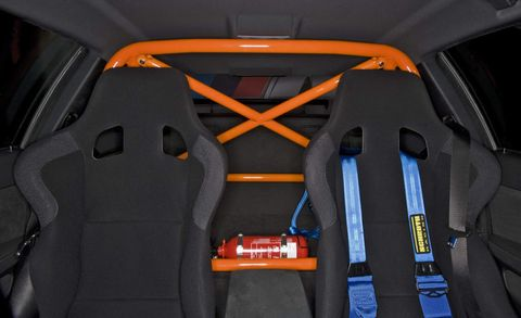 Orange, Car seat, Car seat cover, Vehicle door, Head restraint, Luxury vehicle, Trunk, Seat belt, Leather, Sports car,
