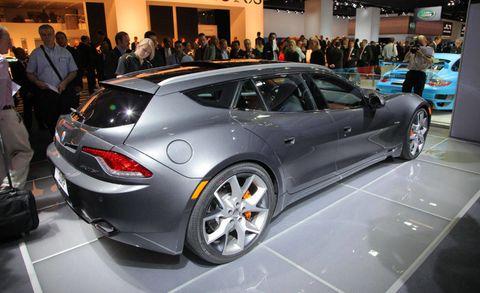 Tire, Wheel, Automotive design, Vehicle, Land vehicle, Event, Car, Personal luxury car, Luxury vehicle, Auto show,