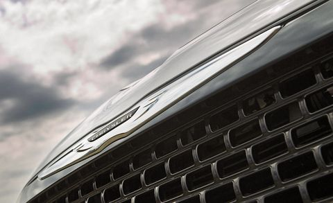 Automotive design, Daytime, Grille, Automotive exterior, Hood, Close-up, Luxury vehicle, Personal luxury car, Ford motor company, Silver,