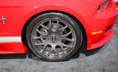 Tire, Wheel, Automotive design, Alloy wheel, Vehicle, Automotive exterior, Rim, Automotive wheel system, Red, Car,