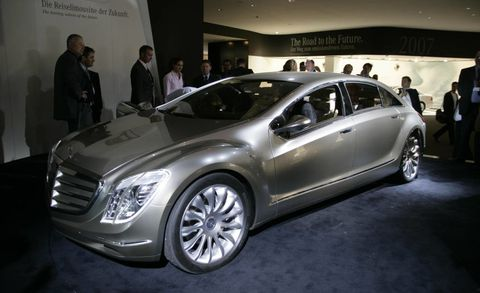Wheel, Automotive design, Vehicle, Land vehicle, Car, Personal luxury car, Luxury vehicle, Auto show, Grille, Exhibition,