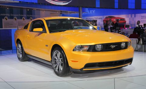 Motor vehicle, Tire, Wheel, Automotive design, Automotive tire, Vehicle, Yellow, Hood, Headlamp, Automotive lighting,