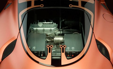 Motor vehicle, Automotive design, Automotive exterior, Orange, Grille, Antique car, Classic, Machine, Auto part, Classic car,