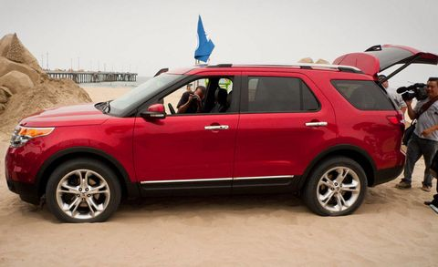 Tire, Wheel, Motor vehicle, Automotive design, Automotive tire, Vehicle, Product, Land vehicle, Car, Red,