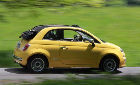 Tire, Wheel, Motor vehicle, Vehicle, Automotive design, Yellow, Land vehicle, Car, Automotive tire, Fender,