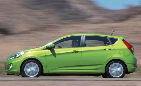 Tire, Wheel, Motor vehicle, Automotive design, Vehicle, Yellow, Automotive wheel system, Green, Car, Rim,