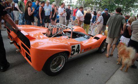 Tire, Automotive design, Vehicle, Carnivore, Orange, Performance car, Race car, Dog, Motorsport, Sports car,