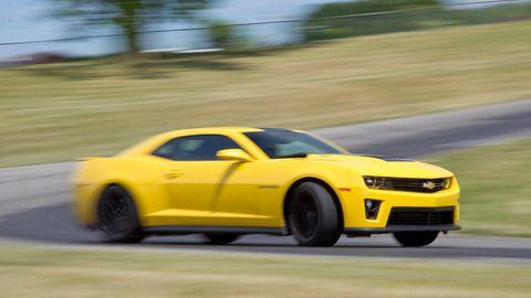 Tire, Wheel, Automotive design, Vehicle, Yellow, Automotive tire, Transport, Land vehicle, Hood, Rim,
