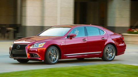 Tire, Wheel, Automotive design, Vehicle, Car, Red, Full-size car, Rim, Mid-size car, Alloy wheel,