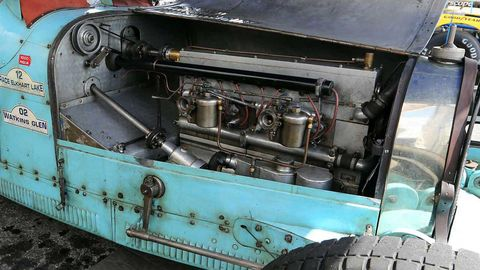 Motor vehicle, Transport, Automotive tire, Automotive exterior, Machine, Tread, Teal, Engine, Auto part, Turquoise,