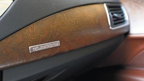 Brown, Watch, Material property, Luxury vehicle, Gloss, Gadget, Watch accessory, Brand, Silver, Leather,