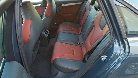 Motor vehicle, Mode of transport, Vehicle door, Car seat, Car seat cover, Fixture, Trunk, Personal luxury car, Luxury vehicle, Seat belt,