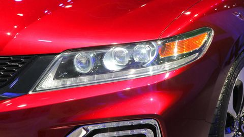 Automotive design, Automotive lighting, Vehicle, Headlamp, Automotive exterior, Event, Grille, Car, Hood, Red,
