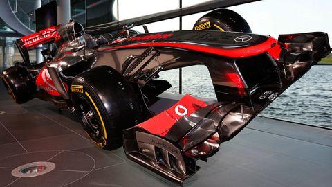 Automotive design, Automotive tire, Open-wheel car, Motorsport, Automotive exterior, Formula one, Logo, Race car, Formula one tyres, Auto part,