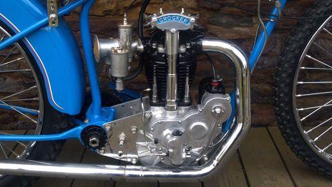 Motor vehicle, Blue, Engine, Automotive tire, Rim, Automotive engine part, Spoke, Electric blue, Machine, Tread,