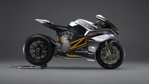 Motorcycle, Wheel, Automotive design, Automotive tire, Rim, Automotive lighting, Automotive wheel system, Spoke, Fender, Motorcycle fairing,