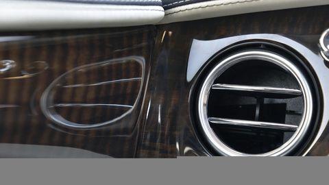Automotive design, Grille, Automotive exterior, Symbol, Hood, Silver, Personal luxury car, Classic, Kit car, Steel,