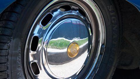 Tire, Wheel, Motor vehicle, Automotive tire, Blue, Automotive wheel system, Alloy wheel, Automotive design, Rim, Synthetic rubber,