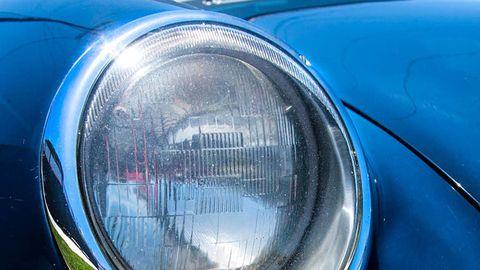 Motor vehicle, Automotive design, Automotive lighting, Headlamp, Automotive parking light, Automotive exterior, Hood, Light, Reflection, Grille,