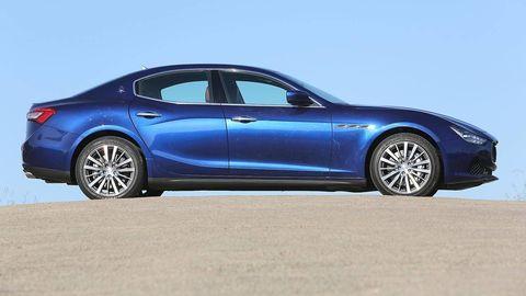 Tire, Wheel, Blue, Automotive design, Vehicle, Land vehicle, Rim, Car, Automotive wheel system, Performance car,