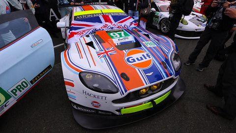 Automotive design, Vehicle, Land vehicle, Performance car, Car, Sports car, Logo, Race car, Supercar, Hood,