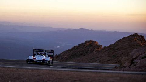 Motor vehicle, Road, Mountainous landforms, Highland, Automotive exterior, Atmosphere, Road surface, Hill, Horizon, Mountain range,