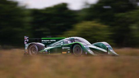 Tire, Wheel, Automotive tire, Automotive design, Automotive wheel system, Motorsport, Rim, Auto part, Race car, Logo,