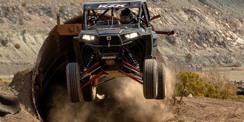Tire, Automotive design, Automotive tire, Automotive exterior, All-terrain vehicle, Off-road vehicle, Landscape, Motorsport, Off-roading, Rim,
