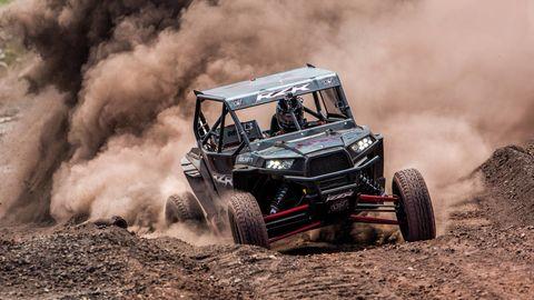 Tire, Automotive design, Automotive tire, Off-road vehicle, Off-roading, Motorsport, Soil, All-terrain vehicle, Auto part, Dust,