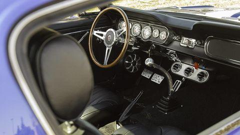 Motor vehicle, Steering part, Mode of transport, Steering wheel, Vehicle, Classic car, Speedometer, Center console, Car, Gauge,