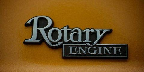 Text, Font, Motor vehicle, Logo, Emblem, Vehicle, Car, Graphics, Brand, Badge,
