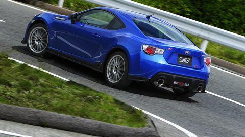 Tire, Wheel, Motor vehicle, Mode of transport, Automotive design, Road, Blue, Vehicle, Land vehicle, Rim,