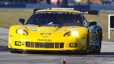 Automotive design, Vehicle, Land vehicle, Yellow, Sports car racing, Headlamp, Car, Motorsport, Performance car, Hood,