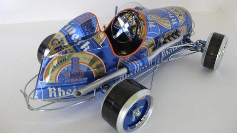 Motor vehicle, Blue, Automotive tire, Automotive design, Automotive wheel system, Open-wheel car, Logo, Auto part, Azure, Cobalt blue,